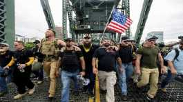 Members of the Proud Boys and other right-wing demonstrators march across the Hawthorne Bridge