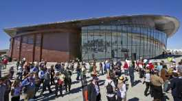 guests stand outside the new Spaceport America hangar in Upham, N.M.