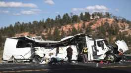 Authorities work the scene where at least four people were killed in a tour bus crash