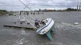 Beaufort Police Officers check a sailboat for occupants in Beaufort, N.C. after Hurricane Dorian