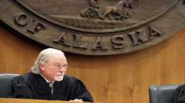 Alaska Supreme Court Justice Craig Stowers listens to arguments in a lawsuit
