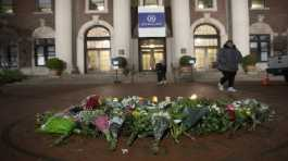 A woman walks past a make-shift memorial for Tessa Majors inside the Barnard College campus