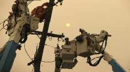 Pacific Gas & Electric crews work to restore power lines in Paradise, Calif