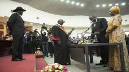 Salva Kiir Mayardit, left, swears in Dr. Riek Machar as the first Vice President of South Sudan