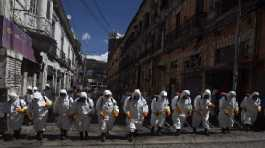 City workers fumigate a street to help contain the spread of the new coronavirus