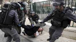 police arrest a man during protest against government's measures to stop the spread of the coronavirus