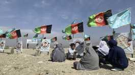 Afghan families at the graves of their relatives
